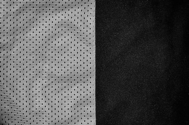 Серая предпосылка текстуры ткани одежды спорта. Premium Фотографии