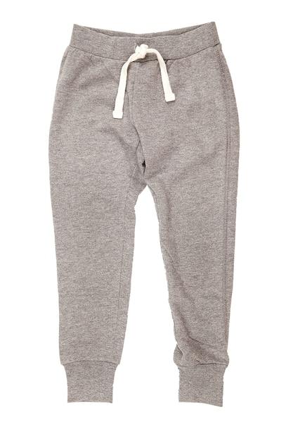 Серые спортивные брюки на белой поверхности. одежда. спорт Premium Фотографии