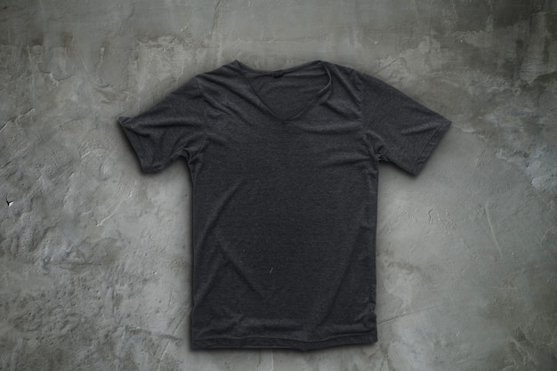 Grey t-shirt on concrete wall background. Premium Photo