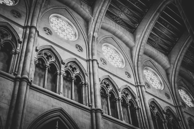 Greyscale low angle shot of the inside of a historic cathedral in spain Free Photo