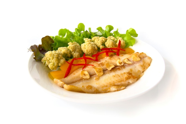 Grill  pangasius dory with cabbage flower and vegetables. Premium Photo