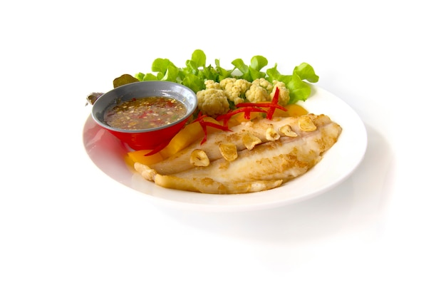 Grill  pangasius dory with dressing spicy sauce or seafood sauce Premium Photo