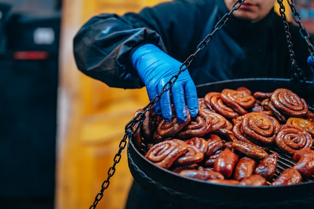Grill with delicious spiral sausages Free Photo