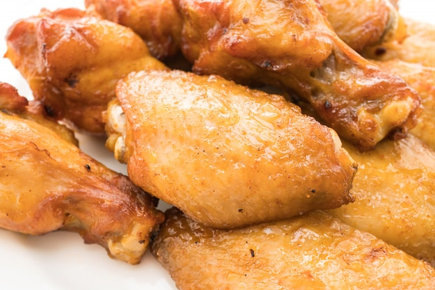 Grilled bbq chicken wing in white plate Free Photo