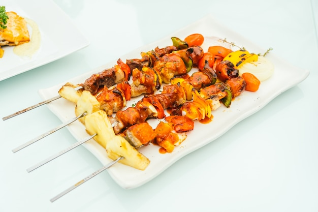 Grilled bbq meat stick in white plate Free Photo