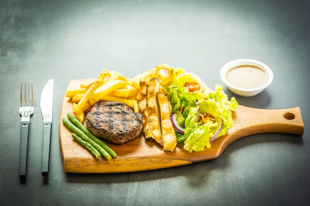 Grilled beef meat steak with french fries sauce Free Photo