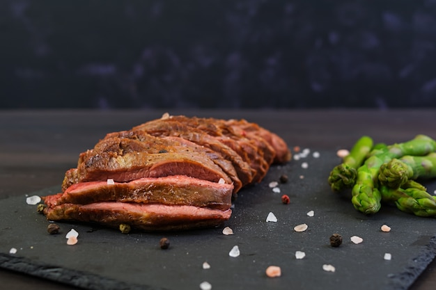 Grilled beef steak and asparagus on wooden Premium Photo