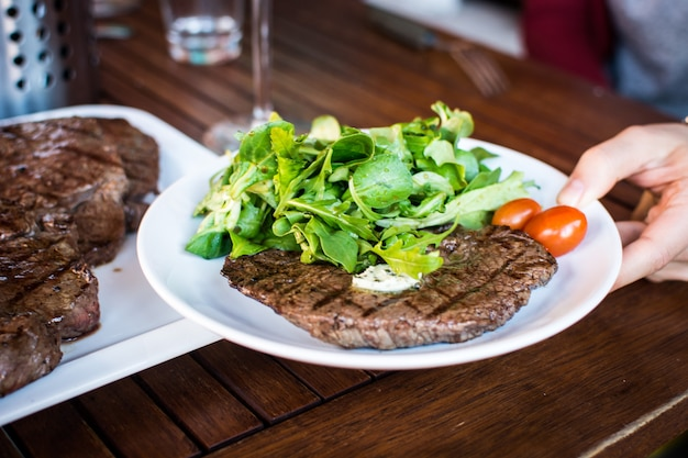 Grilled beef steak with side salad Free Photo