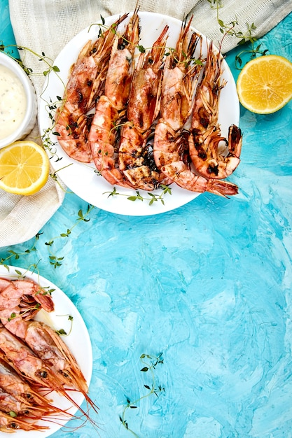 Grilled big tiger shrimps prawns on white plate Premium Photo