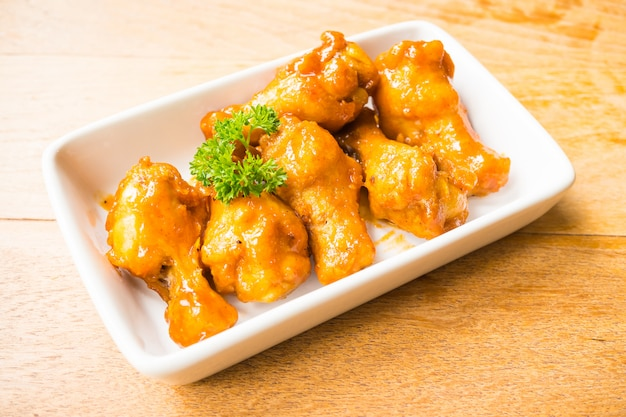 Grilled buffalo wings in white plate Free Photo