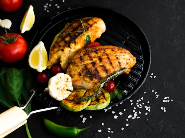 Grilled chicken breasts with vegetables Free Photo