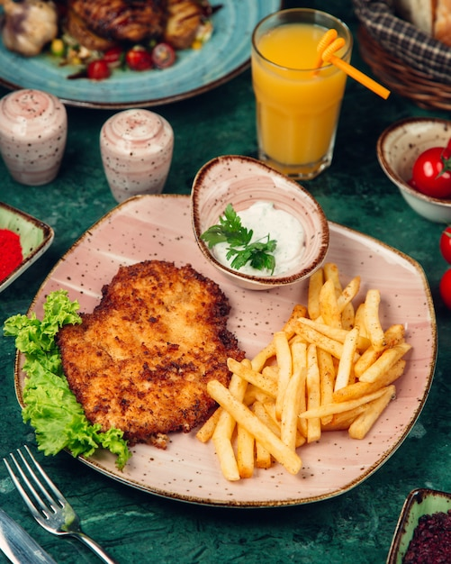 Grilled chicken cut with french fries Free Photo
