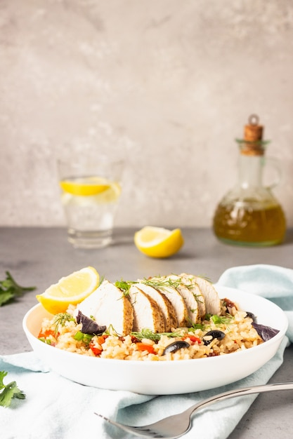 Grilled chicken or turkey with rice and vegetables. Premium Photo