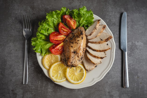 Grilled chicken on a white plate. Free Photo