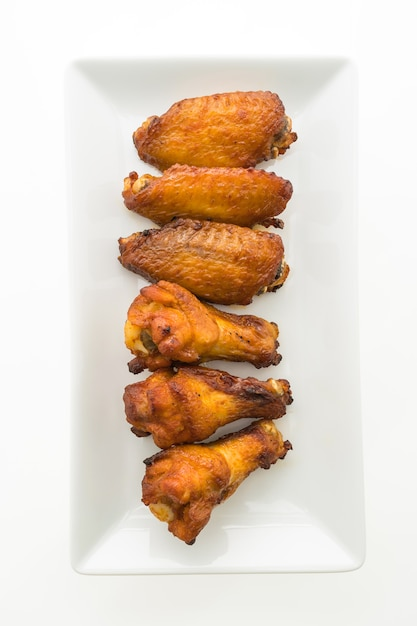 Grilled chicken wing in white plate Free Photo