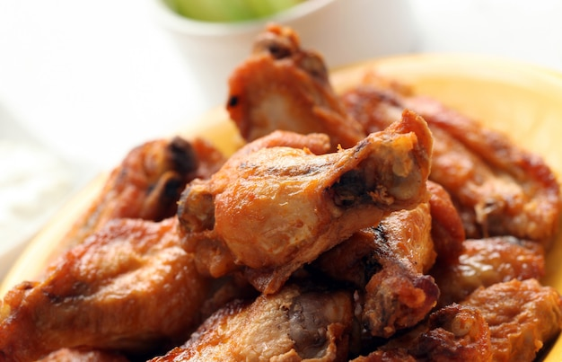 Grilled chicken wings on a white table Free Photo