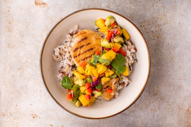 Grilled chicken with mango avocado salsa and rice Premium Photo
