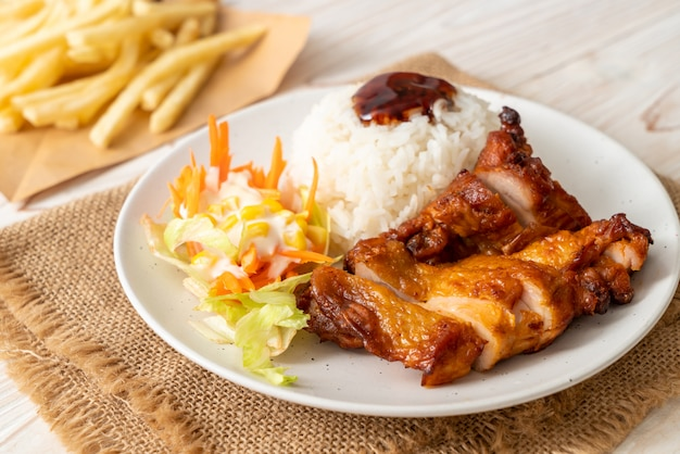 Grilled chicken with teriyaki sauce and rice Premium Photo