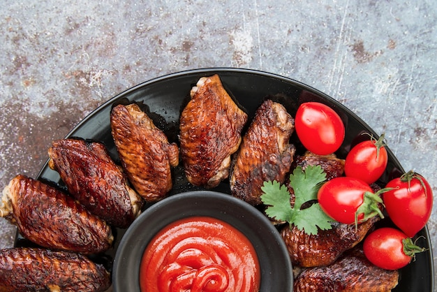 Grilled chicken with tomato sauce and coriander leaf Free Photo
