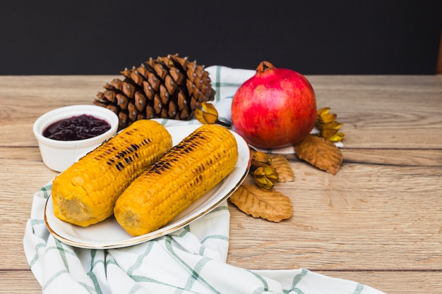 Grilled corns on wooden table Free Photo
