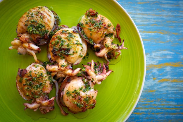 Grilled cuttlefish squid with parsley sauce Premium Photo