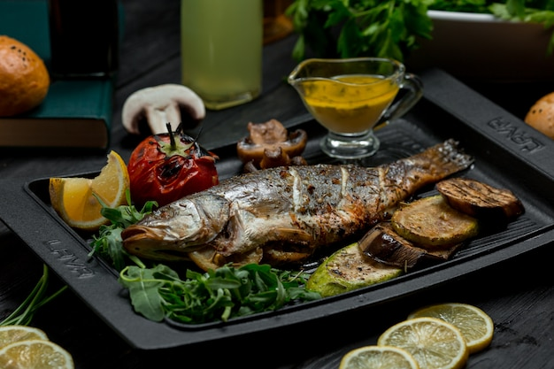 Grilled fish barbecue with vegetables and dip sauce Free Photo