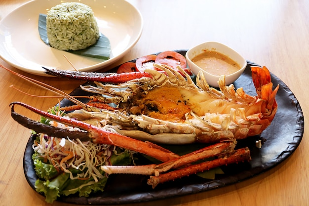 Grilled giant river prawn or river shrimp with cooked rice fried mixed herb. Premium Photo
