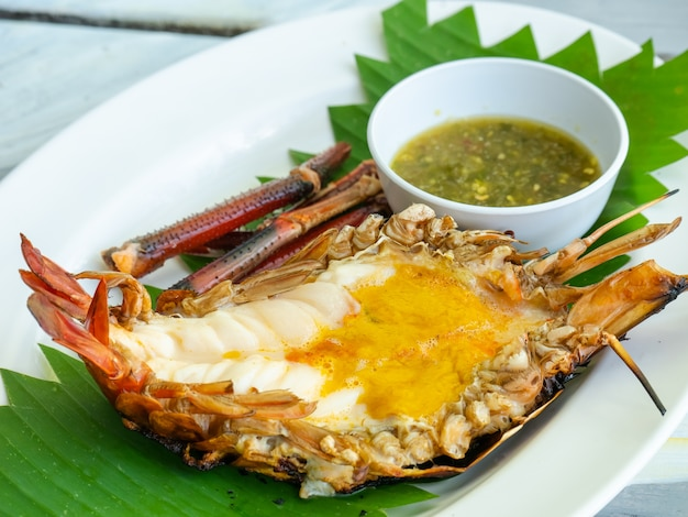 Grilled giant river prawn with spicy seafood dip on plate