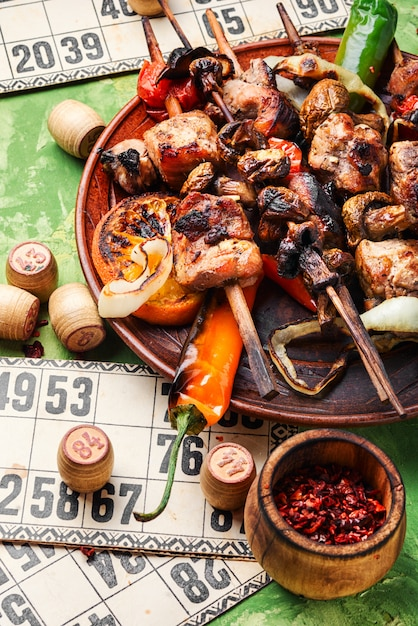 Grilled meat and board games Premium Photo