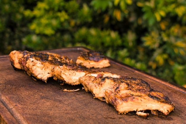 Grilled meat placed on table Free Photo