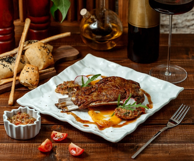 Grilled meat ribs and barbecue salad Free Photo