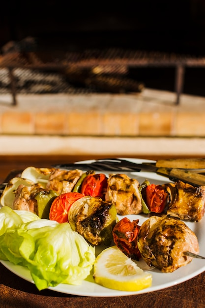 Grilled meat and vegetables on skewers Free Photo