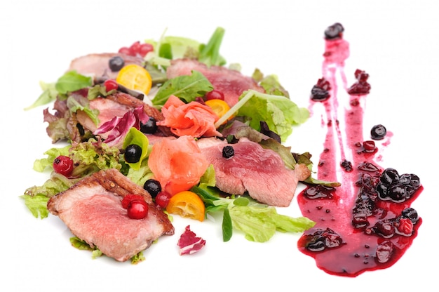 Grilled meat with cranberry and blackcurrant sauce Premium Photo