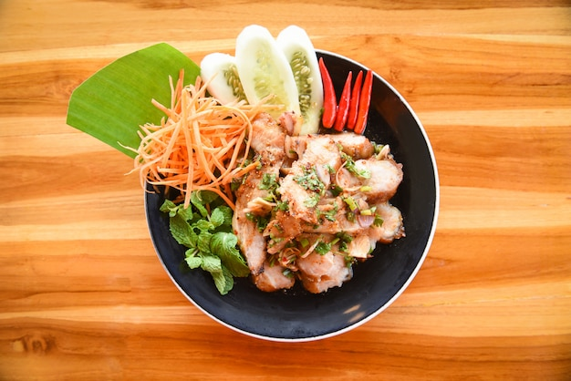Grilled pork salad thai food served on table with herbs and spices ingredients delicious Premium Photo