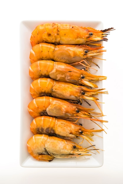 Grilled prawn and shrimp in white plate Free Photo