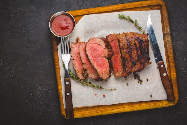 Grilled ribeye beef steak, herbs and spices Premium Photo