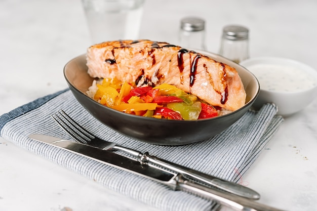 Grilled salmon steak with steamed paprika in a plate Premium Photo