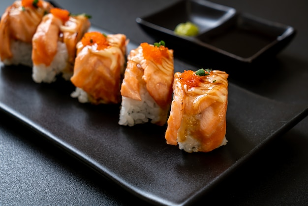 Premium Photo Grilled Salmon Sushi Roll With Sauce