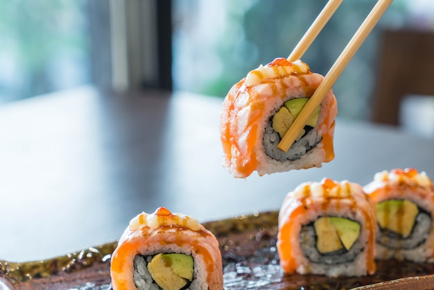 Grilled salmon sushi roll Premium Photo