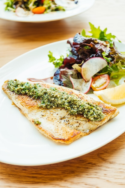 Grilled sea bass fish meat steak with vegetable Free Photo