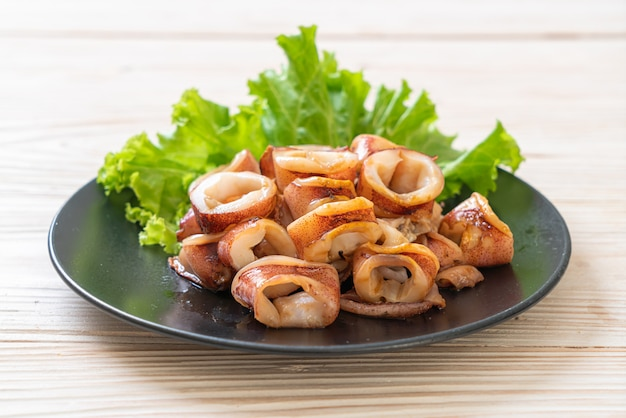 Grilled squid on plate Premium Photo