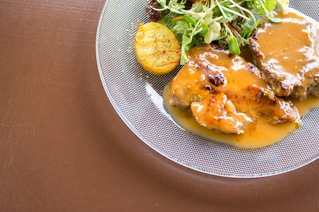 Grilled steak beef, pork and vegetable with swet sauce Premium Photo