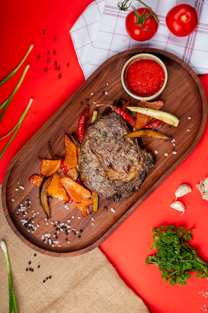 Grilled steak with fried vegetables and ketchup Free Photo
