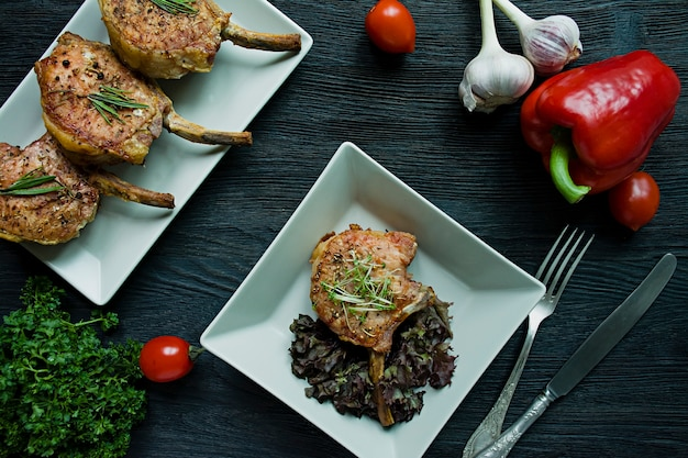 Grilled steaks from pork ribs with spices and herbs. Premium Photo