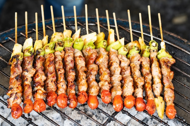 Grilled vegetable and meat skewers Premium Photo