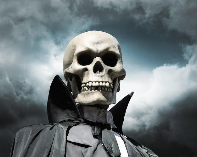 Grim reaper. death's skeleton on a cloudy dramatic sky Premium Photo
