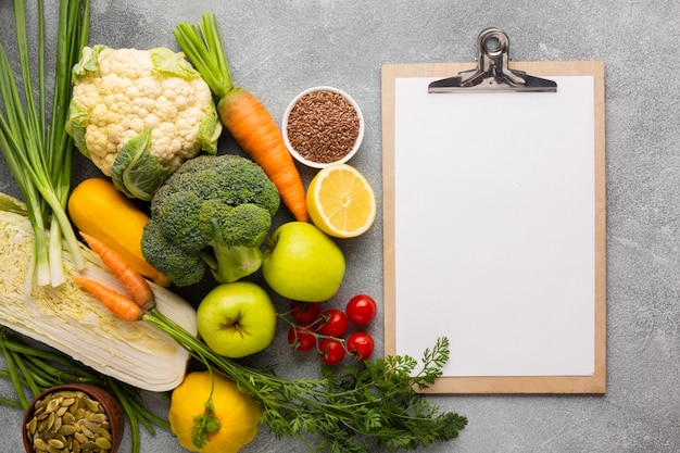 Groceries with clipboard on slate background Free Photo