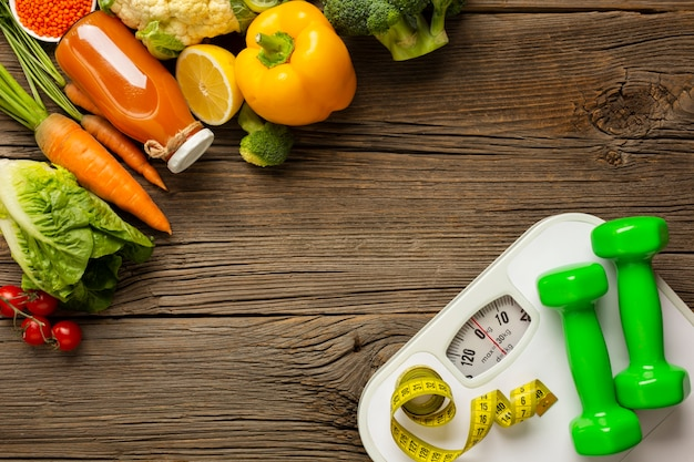 Groceries with scale on wood table Free Photo