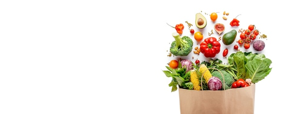 Grocery package with vegetables and cereals on a white. Premium Photo