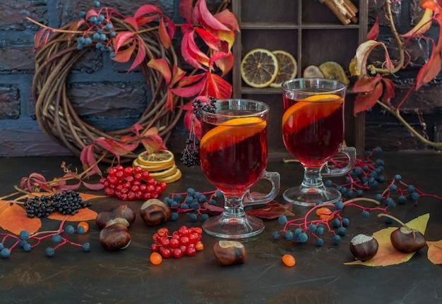 Grog, mulled wine, punch, hot tea with orange Premium Photo